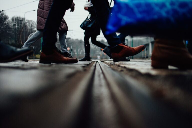 Low angle shot of a group of people walking on the street